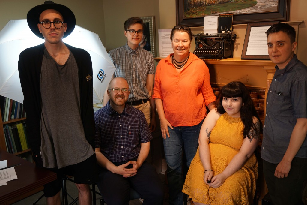 [collaboratory Toronto team together in front of fire place and lighting equipment. from left to right: Oli, Nick, Al, Elspeth, Taryn, and Cait]